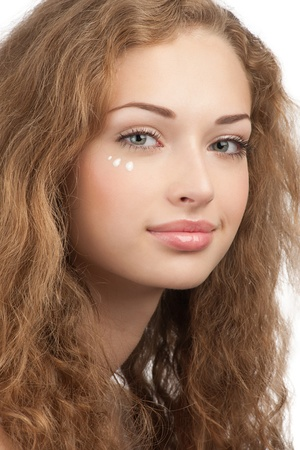 Portrait of young beautiful woman with drops of moisturizer cream on her face, isolated on white background Stock Photo - 10947655