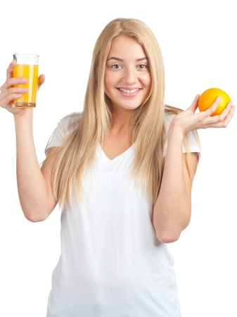 Young woman holding glass of orange juice and ripe orange, isolated on white background photo