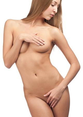 naked woman: Сексуальная красивая женщина, охватывающих ее интимные части голого тела. Изолированные на белом фоне