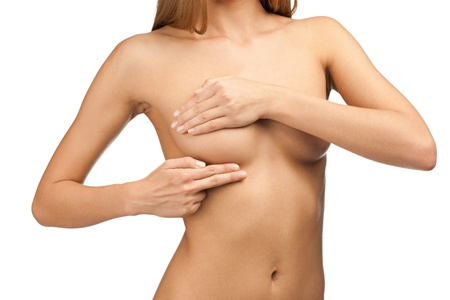 naked woman breasts: Young beautiful woman examining her breast for lumps or signs of breast cancer