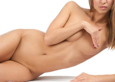 undressed: Sexy naked woman covering her intimate parts of her slim bare body. Isolated on white background Stock Photo