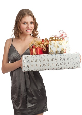 Woman shopping for christmas gifts. Happy young caucasian woman with gifts.  Stock Photo - 11375001