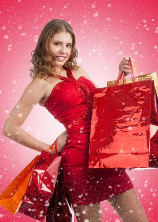 Woman shopping for christmas gifts. Happy young caucasian woman with gifts and shopping bags.  Stock Photo - 11375096