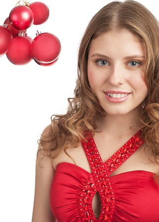 Portrait of pretty young woman with red Christmas balls against white background photo