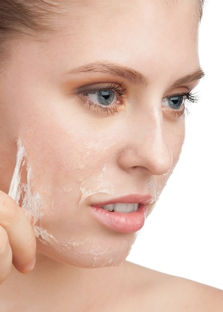 Close-up of beautiful young woman removing old damaged skin from her face Stock Photo - 11375019