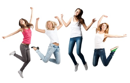 leaping: Group of cheerful young women jumping in air. Isolated on white background