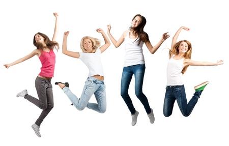 gente celebrando: Grupo de alegres mujeres j�venes saltando en el aire. Aislado sobre fondo blanco