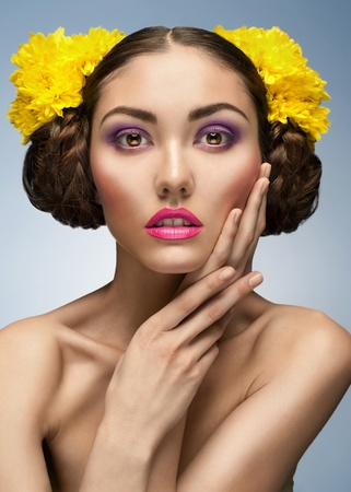 Fashion studio shot of beautiful elegant woman with bright make-up and hairstyle photo