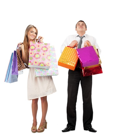 Happy young woman and happy man with colorful shopping bags. Isolated on white background photo