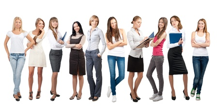 Business team formed of young businesswomen standing in different poses, over a white background