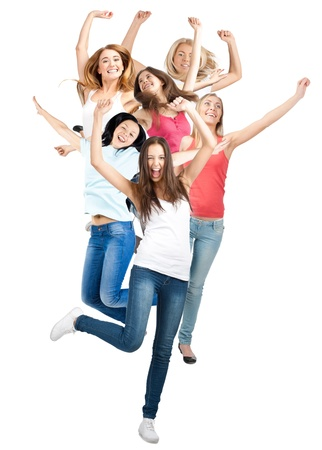 Group of happy young women in motion, jumping in air and laughing. Isolated on white background