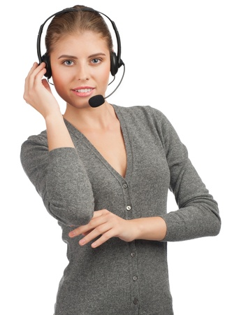 support agent: Portrait of a pretty young female call center employee wearing a headset, against white background Stock Photo