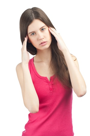Portrait of pretty young woman having a headache, against white background Stock Photo - 11378129