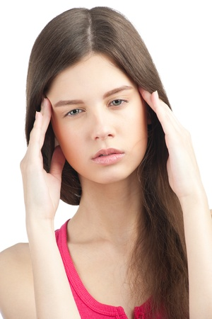 Portrait of pretty young woman having a headache, against white background Stock Photo - 11378649