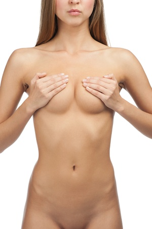 Sexy beautiful woman covering her nude breast. Isolated on white background