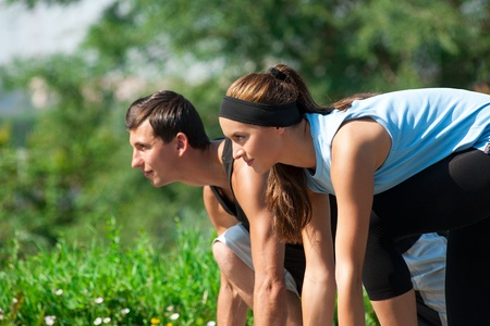 Young fitness couple of man and woman ready to start running  photo