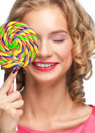 Portrait of beautiful girl with blond curly hair holding lollipop Stock Photo - 11378694