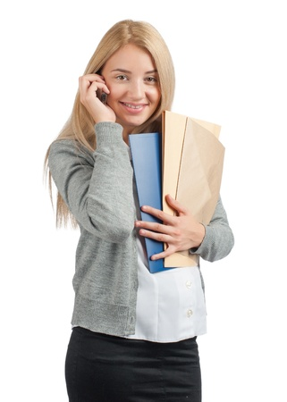 Attractive business woman with documents talking on a cell phone  photo