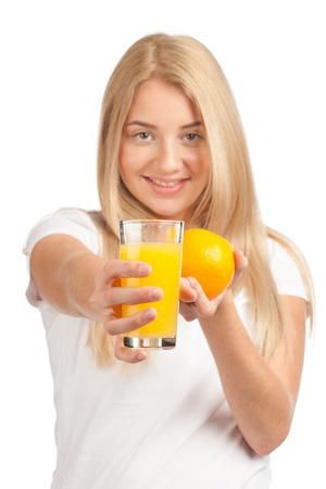 Young woman holding glass of orange juice and ripe orange, isolated on white background photo