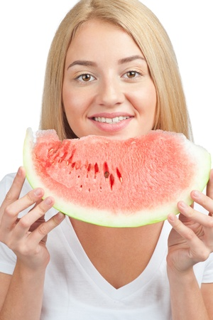 Portrait of young beautiful woman with slice of fresh watermelon photo