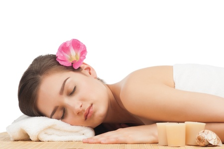 Portrait of young beautiful spa woman with closed eyes lying on bamboo mat at spa salon Stock Photo - 11377972