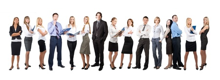 Business team formed of young businessmen and businesswomen standing in different poses, over a white background