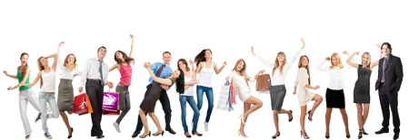 Group of cheerful young women and men in motion, dancing and laughing. Isolated on white background