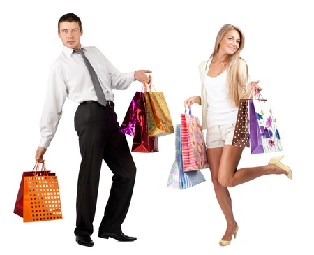 Happy young woman and handsome man with colorful shopping bags. Isolated on white background photo