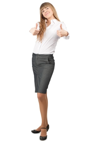 Confident young business woman showing thumbs up sign and smiling, isolated on white background