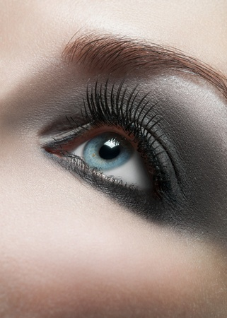 Close-up shot of female eye with bright fashion makeup  photo