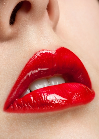 Close-up of sexy woman lips with red lipstick photo