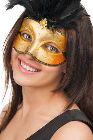 Portrait of a young beautiful woman wearing gold mask photo