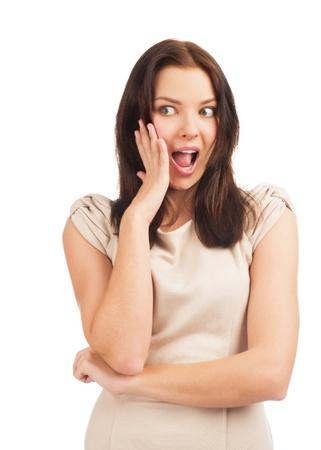 astonishment: Retrato de mujer hermosa sorpresa con la boca abierta tocando la cara de asombro. Aislado sobre fondo blanco.