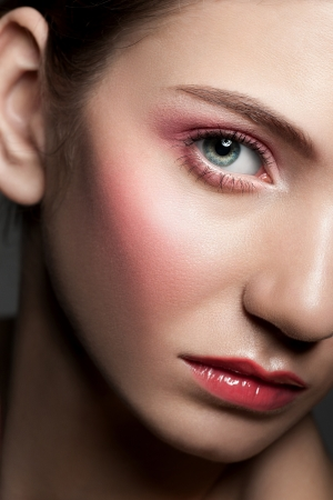Close-up portrait of young beautiful woman with perfect healthy skin and beautiful make-up photo