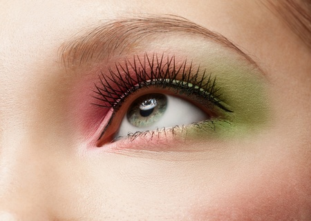 Close-up shot of female eye with bright creativity makeup  photo