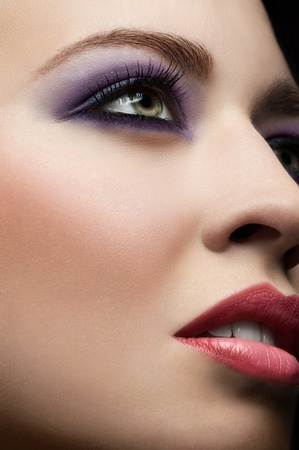 Close-up of young beautiful woman face with stylish make-up