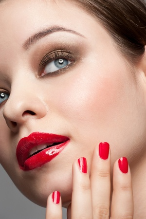 Close-up portrait of young beautiful woman with bright stylish make-up  photo