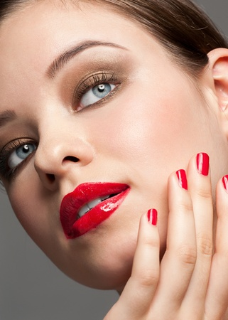 Close-up portrait of young beautiful woman with bright stylish make-up