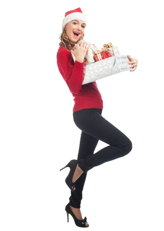 wearing santa hat: Christmas woman holding gifts wearing Santa hat. Standing in full body isolated on white background.
