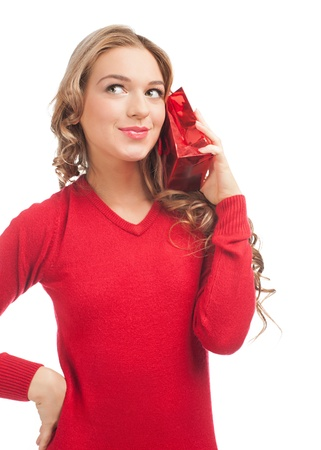Pretty woman with christmas gift. Happy young woman with red shopping bag with gift.  photo
