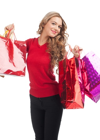Pretty woman shopping for christmas gifts. Happy young woman with colorful shopping bags.  photo