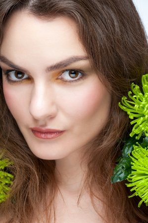 Portrait of young beautiful woman with stylish makeup and green flowers Stock Photo - 11955337