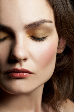 Close-up portrait of young beautiful woman with closed eyes with stylish make-up  photo