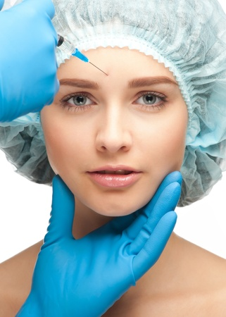 plastic glove: Close-up shot of cosmetic injection of botox to the pretty female face. Isolated on white background Stock Photo