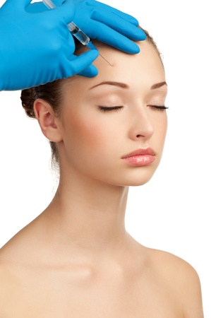 Cosmetic injection of botox to the pretty female face. Isolated on white background Stock Photo - 12794885
