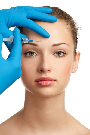 forehead: Cosmetic injection of botox to the pretty female face. Isolated on white background Stock Photo