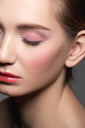 Close-up of young beautiful woman with closed eyes with beautiful make-up Stock Photo - 12797233