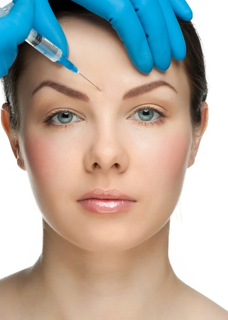 aesthetic: Cosmetic injection of botox to the pretty female face. Isolated on white background Stock Photo