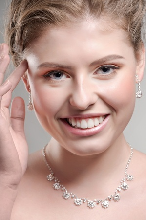 Portrait of beautiful woman with beautiful make-up and hairstyle. Elegant woman with diamond jewelry photo