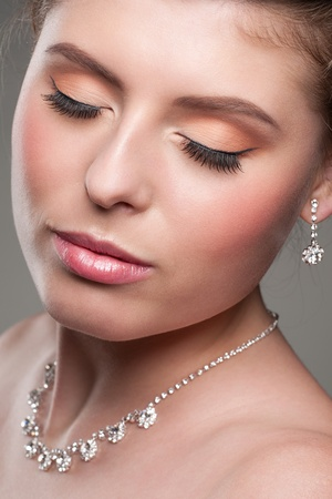Portrait of lovely woman with beautiful makeup and diamond necklace photo